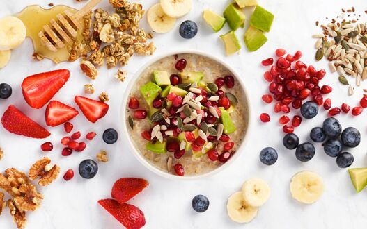 Healthy fruit and grains making up a freshly prepared breakfast bowl